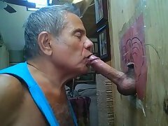 Older mon at his gloryhole worships dick