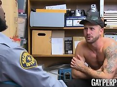 Tattooed hunk riding officers massive black dick