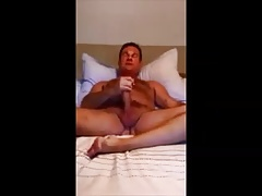 He is cumming on bed